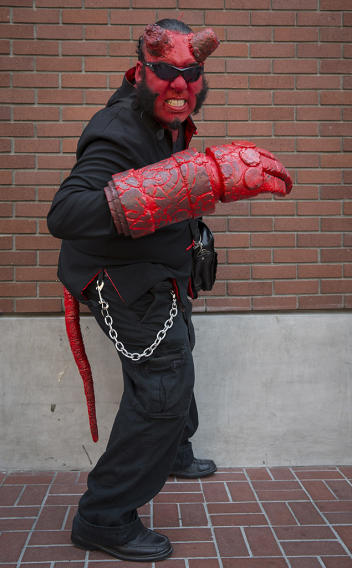 Cosplayer Saturnino Turtle Martinez III poses while dressed as comic book character Hellboy during the 2013 San Diego Comic-Con (SDCC) International