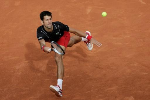 Road back to the top: Novak Djokovic reached his 12th French Open quarter-final with his 200th clay-court win