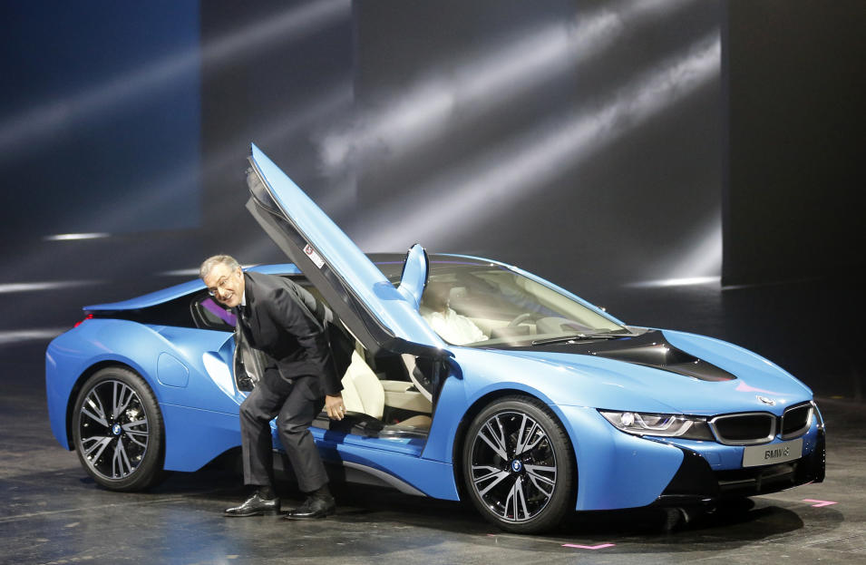 BMW CEO Norbert Reithofer gets out of the BMW i8 plug-in hybrid sports car during its world premiere at the first press day of the 65th Frankfurt Auto Show in Frankfurt, Germany, Tuesday, Sept. 10, 2013. More than 1,000 exhibitors will show their products to the public from Sept. 12 through Sept.22, 2013. (AP Photo/Frank Augstein)