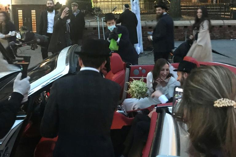 A Hasidic Jewish wedding in Brooklyn stood in stark contrast to an upended New York that's seen shops shut down, Times Square empty out and many of its more than eight million residents hole up at home