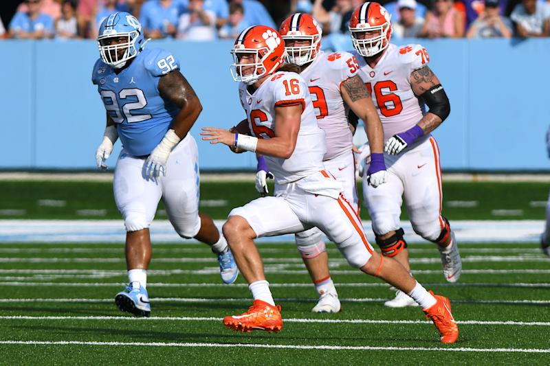 CHAPEL HILL, NC - SEPTEMBER 28: Clemson Tigers quarterback Trevor Lawrence (16) runs the ball up the middle in the game between the Clemson Tigers and the North Carolina Tar Heels on September 28, 2019 at Kenen Memorial Stadium in Chapel Hill, NC.(Photo by Dannie Walls/Icon Sportswire via Getty Images)