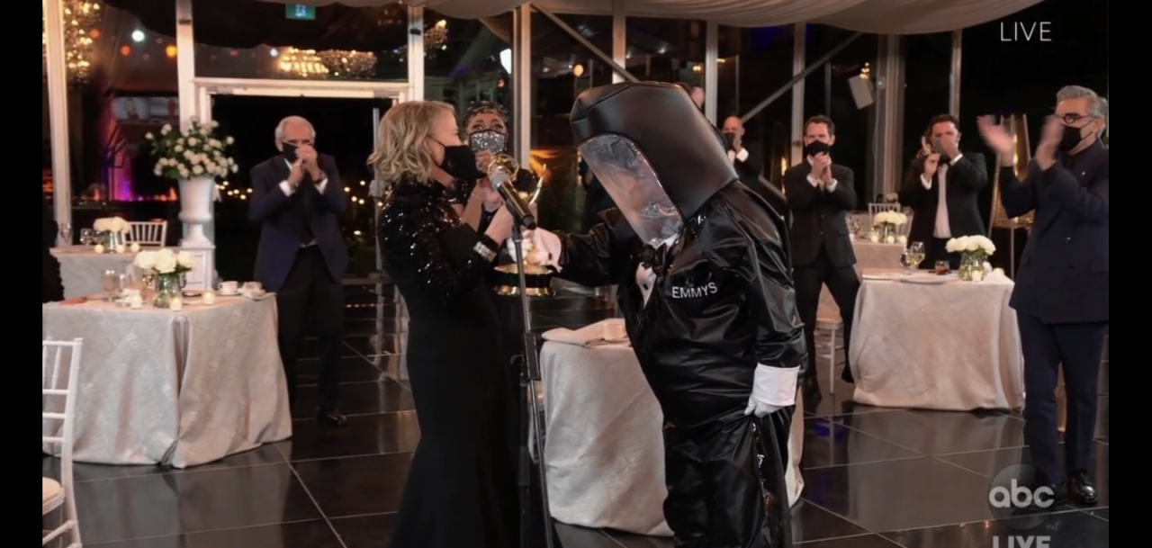<p>In an effort to safely deliver Emmys to winners, the 2020 Emmys deployed trophy presenters clad in hazmat suits. But this is an award show after all, so the hazmat suits were made to resemble tuxes. It's a pandemic vibe. </p>