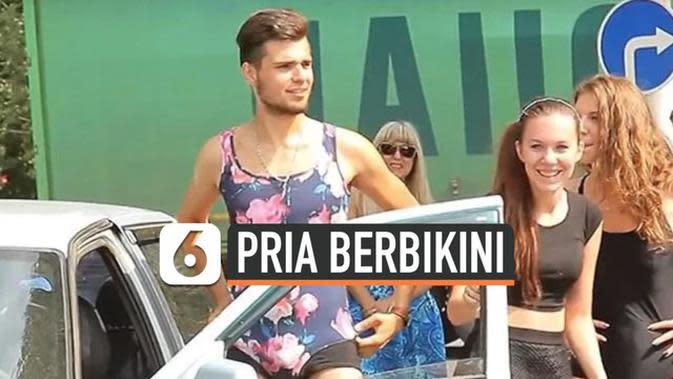 VIDEO: Pria di Rusia Pakai Bikini Agar Dapat Bensin Gratis
