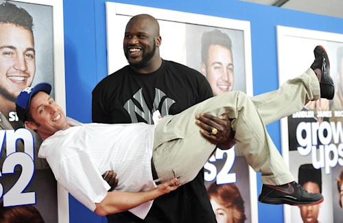 "Former professional basketball player Shaquille O'Neal gives actor Adam Sandler a lift at the premiere of ""Grown Ups 2"" at the AMC Loews Lincoln Square on Wednesday, July 10, 2013 in New York. (Photo by Evan Agostini/Invision/AP)"