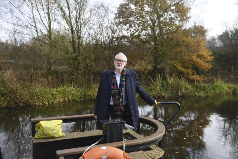 Britain's Labour Party leader Jeremy Corbyn stands on The Oatcake Boat owned by Kay Mundy in Stoke-on-Trent, England, Friday Nov. 22, 2019, ahead of the general election on Dec. 12. (Joe Giddens/PA via AP)