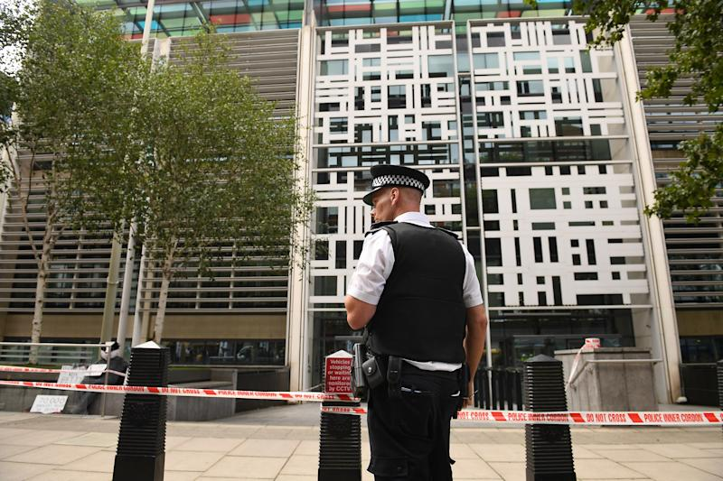Police officers at the government building in Marsham Street in Westminster, after the shocking incident. (PA)