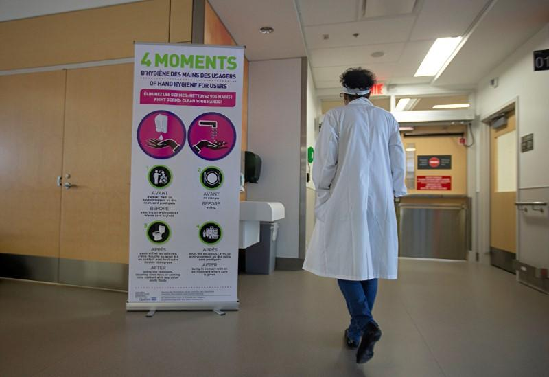 FILE PHOTO: Sign for washing hands is seen during a news media tour of quarantine facilities for treating novel coronavirus at Jewish General Hospital in Montreal