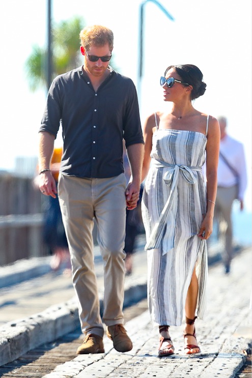 <p>After a day of resting Meghan wore a floaty linen dress by American eco-friendly brand Reformation, and her Sarah Flint Grear sandals, for stroll with Harry. Photo: Getty </p>