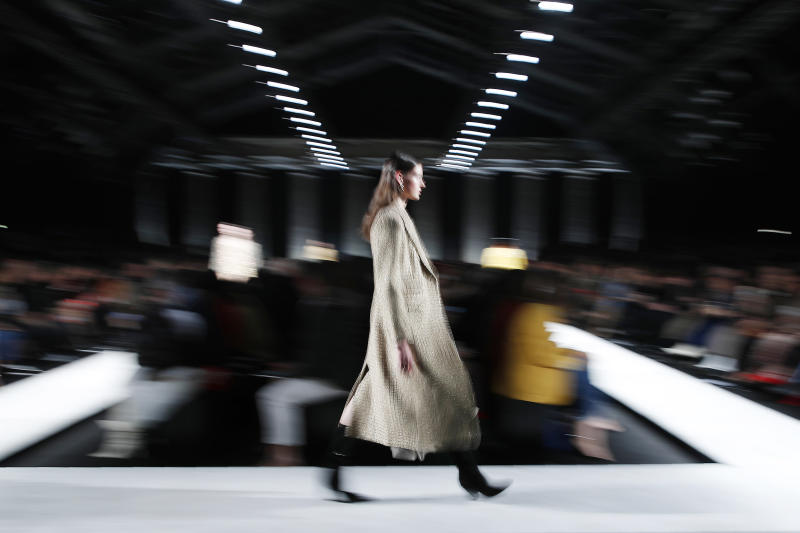 A model wears a creation as part of the Ermanno Scervino women's Fall Winter 2020-21 collection, unveiled during the Fashion Week in Milan, Italy, Saturday, Feb. 22, 2020. (AP Photo/Antonio Calanni)