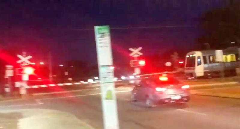 Perth police chase sees 4WD and trailer escape under train