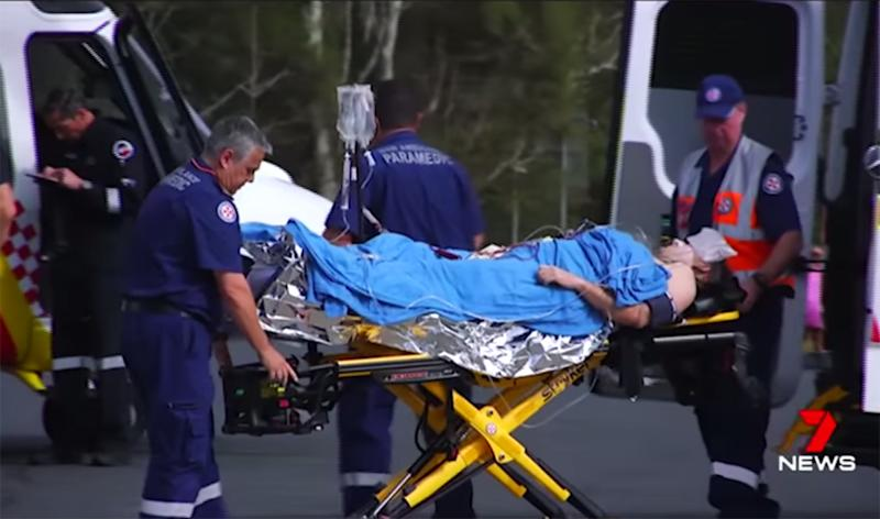 A shark attack victim is transported on a stretcher after the attack at Nambucca Heads on Sunday morning.