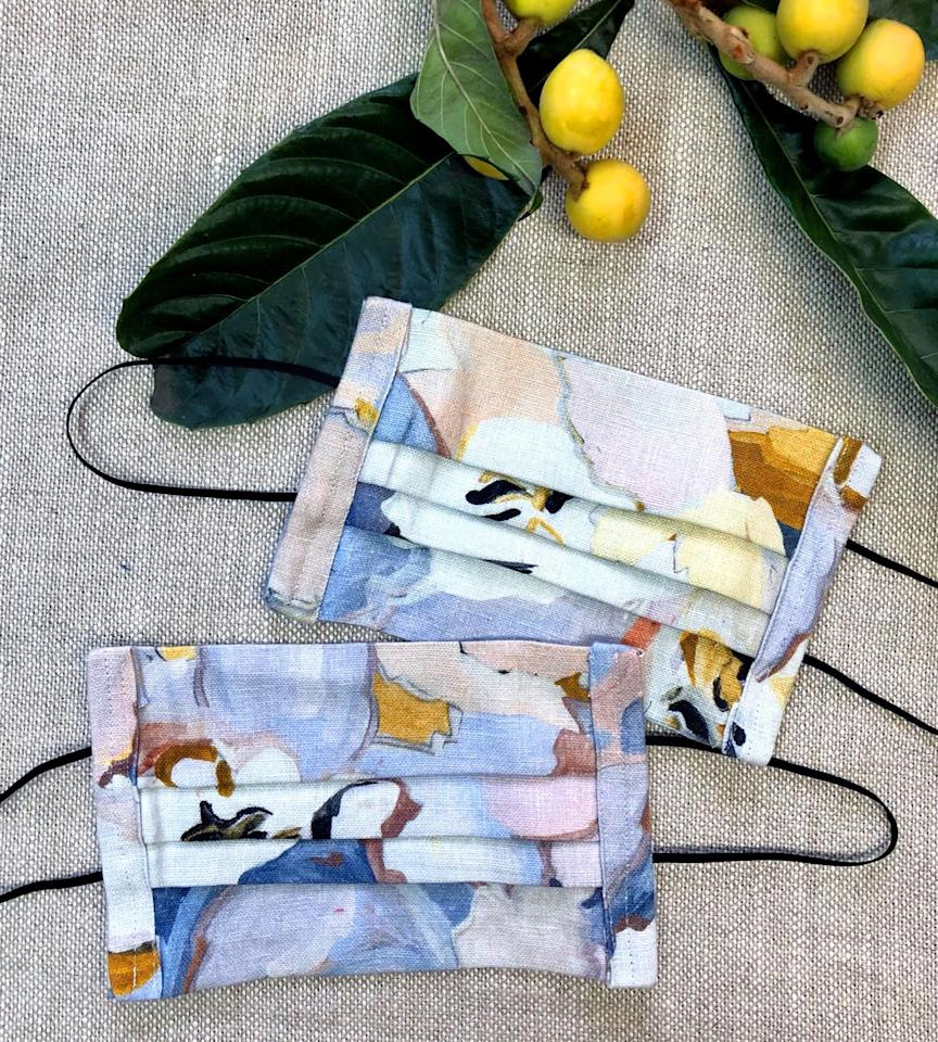 """<p><a class=""""body-btn-link"""" href=""""https://voutsa.com/collections/lifestyle/products/maude-linen-face-mask"""" target=""""_blank"""">BUY NOW</a></p><p><strong>Maude Linen Face Mask</strong></p><p><strong></strong>Fabric designer George Venson is making some of his beloved (and Instagram-famous) patterns into chic, linen masks hand sewn by artist John Parot. The best part? 10% of all proceeds will be donated to the <a href=""""https://lalgbtcenter.org/?gclid=EAIaIQobChMI_orCieO26QIVxJ6zCh39_gjSEAAYASAAEgI8_PD_BwE"""">Los Angeles LGBT Center</a>. </p>"""