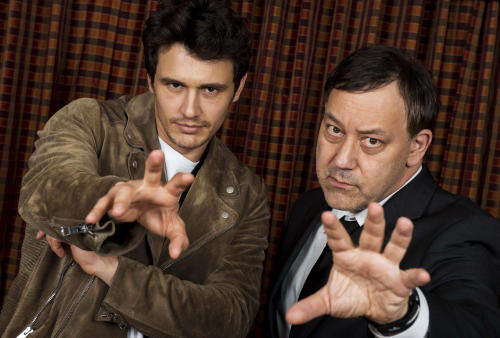 """FILE - In this Sunday, Feb. 17, 2013 file photo, actor James Franco, left, and director Sam Raimi pose for portraits at the """"Oz The Great and Powerful"""" press junket at the Langham Huntington Hotel, in Los Angeles. Returning to the mystical land of """"The Wizard of Oz"""" apparently takes more than 70 years and hundreds of millions of dollars. Disney will release its anticipated prequel to the 1939 movie on Friday, Feb. 7, 2013. Directed by Raimi, """"Oz the Great and Powerful"""" explores the origins of the wizard (James Franco) and the witches (Mila Kunis, Michelle Williams and Rachel Weisz) in a three-dimensional Oz. (Photo by Jordan Strauss/Invision/AP, File)"""