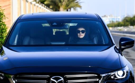 Hala Hussein Alireza, a newly-licensed Saudi motorist, drives a car on a main road in the Red Sea coastal city of Jeddah