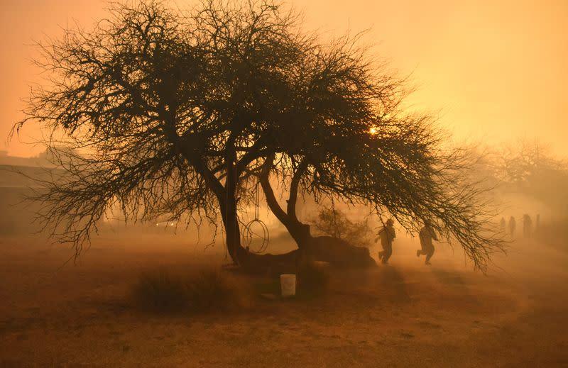 In Argentina's ranch heartlands, dry winds fan blazes as firefighters battle for control
