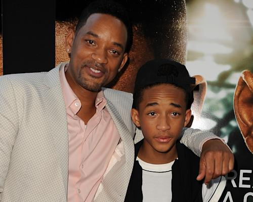 "FILE - In this Thursday, May 16, 2013 file photo, Will Smith, left, and Jaden Smith attend ""After Earth"" Day at the Miami Science Museum in Miami, Fla. The film, ""After Earth,"" opens May 31 in the US, and is set in a future where nature has turned on humans and survivors were forced to start a new civilization on another planet. Jaden plays a trainee trying to follow in the footsteps of his father, a famous military leader played by Smith. (Photo by Jeff Daly/Invision/AP, File)"
