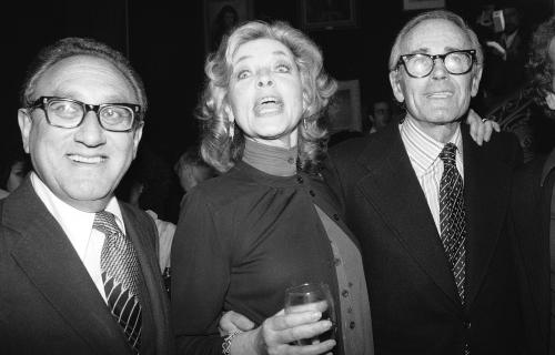 "FILE - This June 8, 1979 file photo shows actress Lauren Bacall, center, with Henry Kissinger, left, and actor Henry Fonda at a party to launch her autobiography,""By Myself"" at the Palace Theater in New York. Bacall, the sultry-voiced actress and Humphrey Bogart's partner off and on the screen, died Tuesday, Aug. 12, 2014 in New York. She was 89. (AP Photo/Ron Frehm, FIle)"
