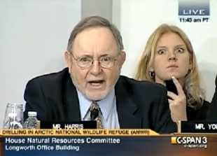 Young Staffer Makes Crazy Faces at the Camera During Congressional Hearing