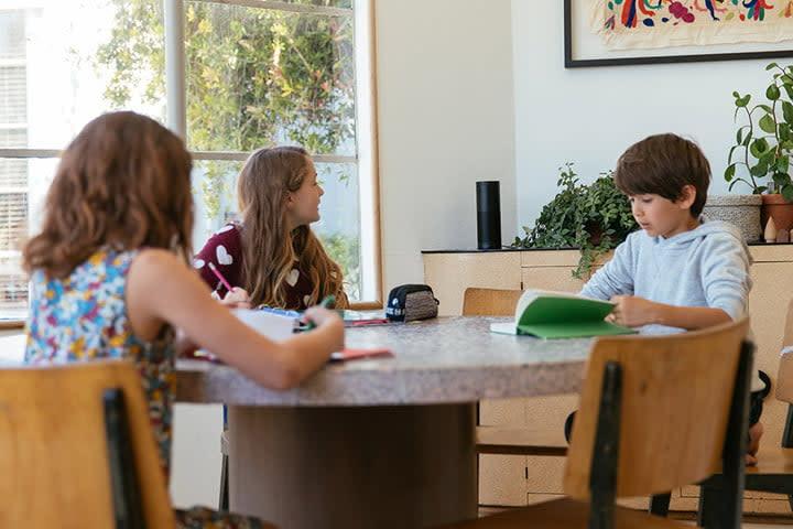 kids doing homework around Amazon Echo
