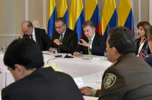 President Juan Manuel Santos, center, meets with the National Council of Narcotic Drugs at the Narino Palace in Bogota