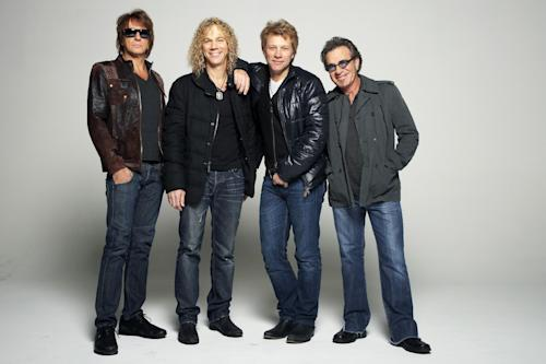 In this Nov. 29, 2012, photo, rock band Bon Jovi, from left, Richie Sambora, David Bryan, Jon Bon Jovi and Tico Torres pose for a portrait in the Brooklyn Borough of New York. Bon Jovi was in a jovial mood when he sat down with The Associated Press last week to discuss his group's upcoming projects, but turned somber when he discussed the some of the more painful events to hit him in 2012. (Photo by Dan Hallman/Invision/AP)