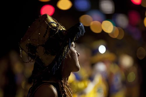 "A member of the murga ""Los amantes de La Boca"" participates in carnival celebrations in Buenos Aires, Argentina, Saturday, Feb. 2, 2013. Argentina's carnival celebrations may not be as well-known as the ones in neighboring Uruguay and Brazil, but residents of the nation's capital are equally passionate about their ""murgas,"" or traditional musical troupes. The murga ""Los amantes de La Boca,"" or ""The Lovers of The Boca"" is among the largest, with about 400 members. It's a reference to the hometown Boca Juniors, among the most popular soccer teams in Argentina and the world. (AP Photo/Natacha Pisarenko)"