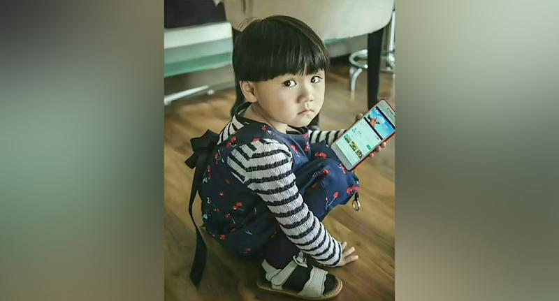 Little girl Tan Ziyue (pictured) became the subject of a city-wide search in Xuanwei in south-western China's Yunnan province after she disappeared on August 25 and was found minutes from boarding a train to be sold in child trafficking activities