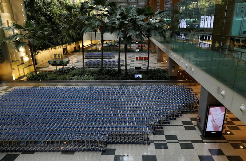 A view of an empty baggage collection area, as airlines reduce flights following the outbreak of the coronavirus disease (COVID-19), at Singapore's Changi Airport March 23, 2020. REUTERS/Edgar Su
