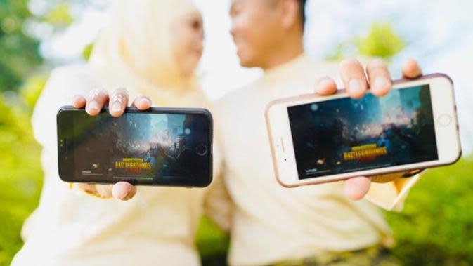 Irna Izzany Khairuddin dan Mohd Azmil Shahrizal Harun yang menikah karena bertemu di PUBG (Sumber: mStar)
