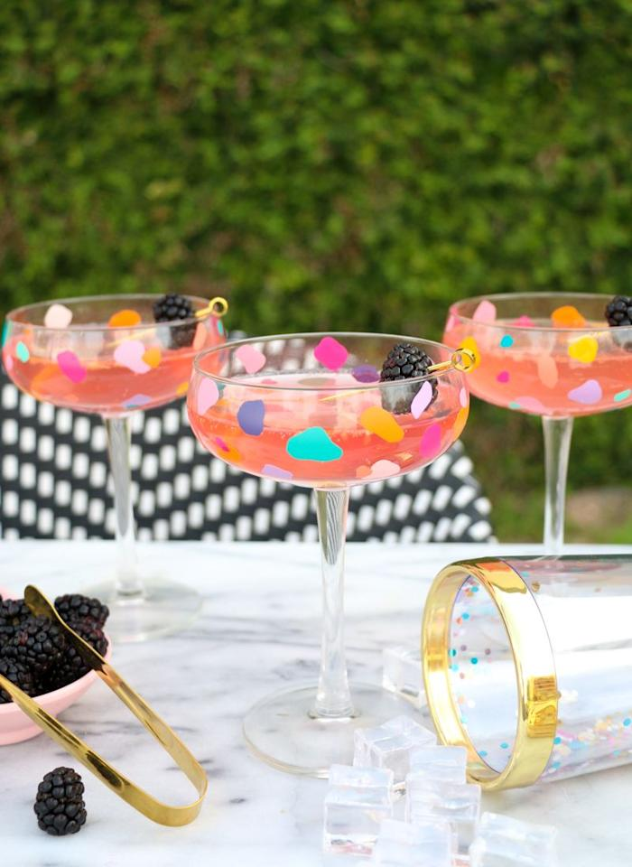 """<p>Make these eye-catching cocktail glasses with just a bit of scrap adhesive vinyl and cheap glasses from Ikea or the dollar store. This project is super easy, but will create a dazzling result your cocktail party guests will be sure to admire.</p><p><em><a href=""""https://akailochiclife.com/2019/03/diy-confetti-coupe-cocktail-glasses.html"""" target=""""_blank"""">Get the tutorial from A Kailo Chic Life  »</a></em></p>"""