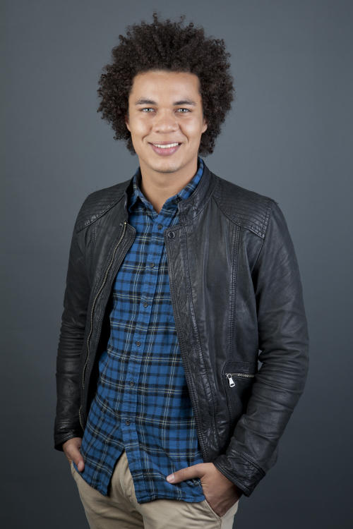 """This April 30, 2013 photo shows Puerto Rican actor Ismael Cruz Cordova, 26, of """"Sesame Street,"""" posing in New York. Cruz plays Mando, a young Latino writer who interacts with the puppets and also loves technology. (Photo by Amy Sussman/Invision/AP)"""