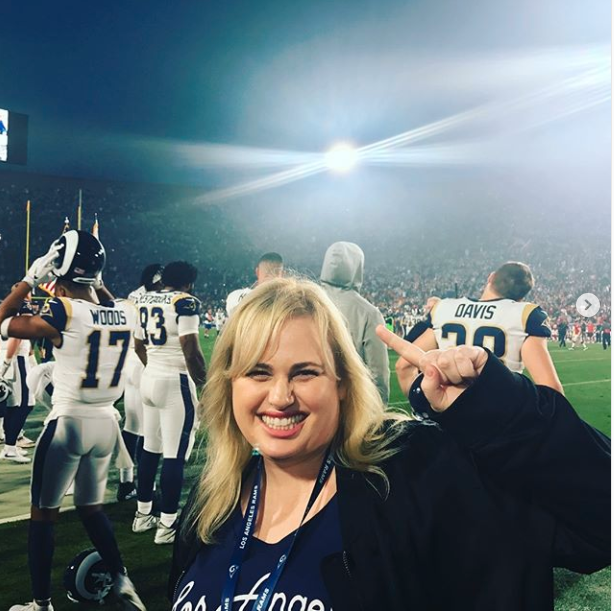 "<p>""Let's go Rams! I love you no matter what happens, you guys are legends"", Rebel captioned this pic from the sideline. Photo: Instagram/Rebel Wilson </p>"