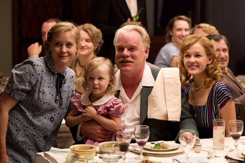 """This film image released by The Weinstein Company shows Amy Adams, left, and Philip Seymour Hoffman, center, in a scene from """"The Master."""" The film will be presented at the 37th Toronto International Film festival running through Sept. 16. (AP Photo/The Weinstein Company)"""