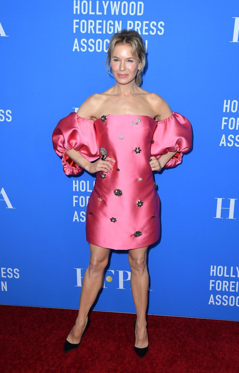 Renee Zellweger wore an 80s style pink mini dress. [Photo: Getty]