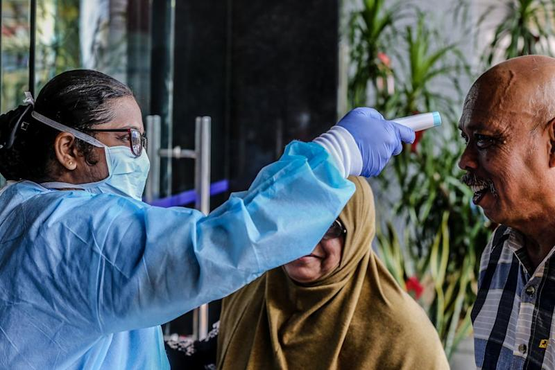 Medical personnel check the temperature of a visitor at the entrance of KPJ Tawakkal hospital in Kuala Lumpur, January 28, 2020. — Picture by Firdaus Latif