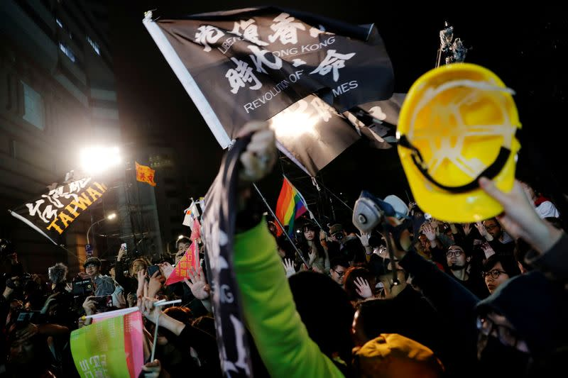 Flight of Hong Kong protesters piles pressure on Taiwan