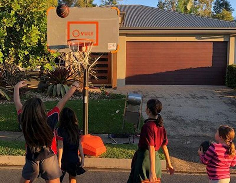 Children are pictured playing basketball at the portable hoop in the Sunshine Coast suburb of Brightwater.