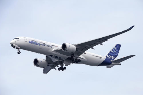 An Airbus A350-900 flies during an aerial display for a media preview ahead of the upcoming Singapore Air Show on Sunday, Feb. 9, 2014. (AP Photo/Joseph Nair)