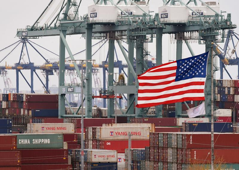 Chinese shipping containers are stored beside a US flag after they were unloaded at the Port of Los Angeles in Long Beach, California on May 14, 2019. - Global markets remain on red alert over a trade war between the two superpowers China and the US, that most observers warn could shatter global economic growth, and hurt demand for commodities like oil. (Photo by Mark RALSTON / AFP) (Photo credit should read MARK RALSTON/AFP/Getty Images)