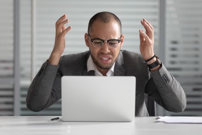 man angry at laptop