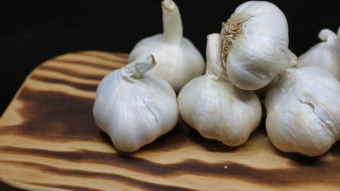 ilustrasi manfaat mengonsumsi bawang putih mentah agar tidak mudah terserang penyakit/Nick Collins/pexels