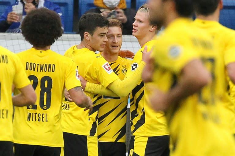 Replacements Haaland, Reus combine to send Dortmund second