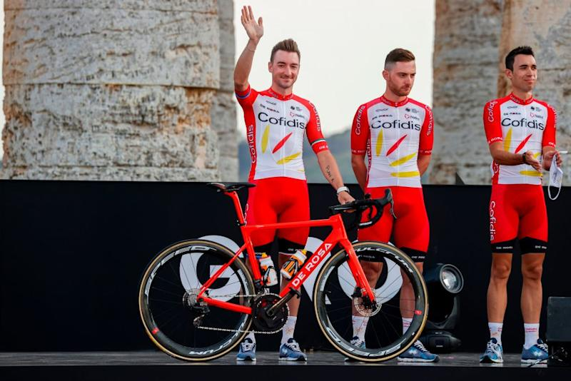 Italys Elia Viviani L of Cofidis Team waves on stage at the Doric Temple of Segesta near Palermo Sicily on October 1 2020 during an opening ceremony of presentation of participating teams and riders two days ahead of the departure of the Giro dItalia 2020 cycling race Photo by Luca Bettini AFP Photo by LUCA BETTINIAFP via Getty Images
