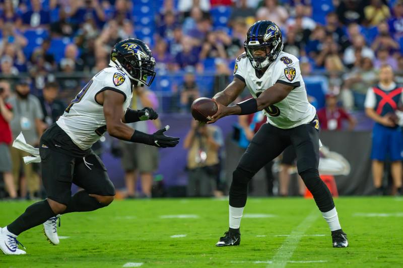Baltimore Ravens quarterback Lamar Jackson (8) hands off to running back Mark Ingram (21)