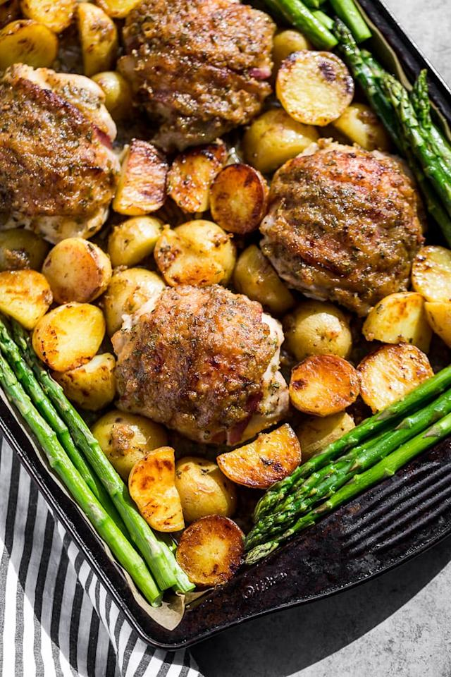 "<p>Sheet-pan dinners allow you to cook all of your meal components at once, freeing you up to do other things. After cooking, portion out these bacon-wrapped, honey-mustard-smothered chicken thighs into individual containers with a scoop of potatoes and asparagus for four healthy meals.</p> <p><strong>Get the recipe:</strong> <a href=""https://getinspiredeveryday.com/food/honey-mustard-chicken-and-potato-sheet-pan-dinner/"" target=""_blank"" class=""ga-track"" data-ga-category=""Related"" data-ga-label=""https://getinspiredeveryday.com/food/honey-mustard-chicken-and-potato-sheet-pan-dinner/"" data-ga-action=""In-Line Links"">honey mustard chicken and potatoes</a></p>"