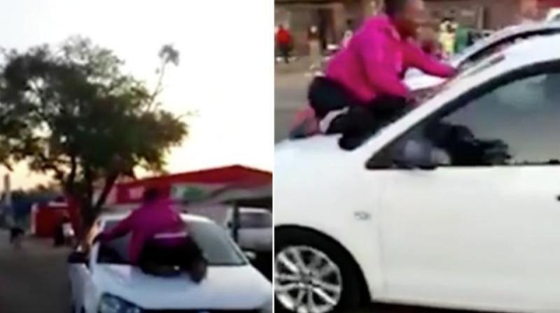 Wife on car hood