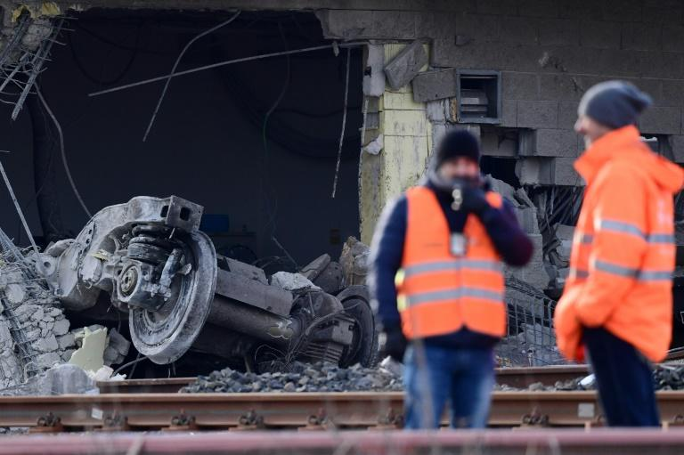 The engine reportedly went off the rails and struck a freight wagon on a parallel track before hitting the building