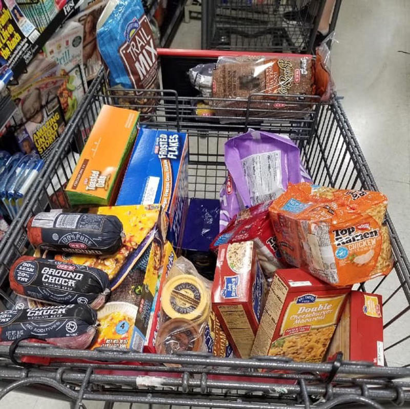 The trolley of groceries an Austin, Texas police officer bought for the family of a young boy he found alone outside a supermarket.