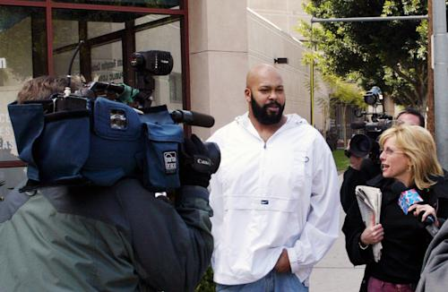 "** FILE ** In this Feb. 26, 2003 file photo, rap music mogul Marion ""Suge"" Knight, walks out of the Los Angeles County jail in Los Angeles. Knight appeared in a Los Angeles courtroom on Tuesday, Dec. 23, 2014, and was ordered to return to court on Jan. 27, 2015, for the next hearing in a felony robbery case filed after a celebrity photographer reported that he stole her camera in September. (AP Photo/Damian Dovarganes, File)"
