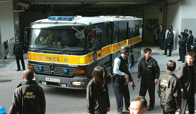 Kwai Ping-hung arrives at Eastern Magistrates' Court in Sai Wan Ho under heavy security in December 2003. Photo: Martin Chan